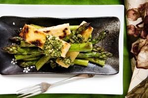 Asparagus, rice flour-fried tofu and cashew mint sauce. Photo / Babiche Martens