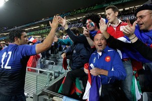 Fans celebrate with French second-five Maxime Mermoz after the semi-final match between Wales and France. Photo / Brett Phibbs