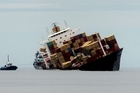 The stricken cargo ship Rena. Photo / Alan Gibson
