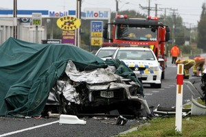 Emergancy service attend a fatal two car crash at the intersection of Petane Road and Main North Road in Napier. Photo / Glenn Taylor