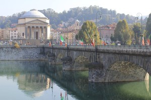A bridge in Turin is adorned with Italian flags. Photo / Charlotte Whale