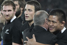 The All Blacks celebrate at the final whistle. Photo / Brett Phibbs