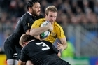 Piri Weepu and Owen Franks tackle Australia's Pat McCabe. Photo / Brett Phibbs