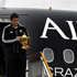 Richie McCaw disembarks the Air New Zealand Boeing 737 charter flight from Auckland to Christchurch this morning, with the Webb Ellis Cup. Photo / Sarah Ivey