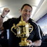 All Black assistant coach Steve Hansen with the Webb Ellis Cup on the flight from Auckland to Christchurch this morning. Photo / Sarah Ivey