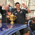 Dan Carter and Graham Henry greet the crowds. Photo / Geoff Sloan