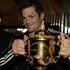 Richie McCaw with the Webb Elllis Cup as fans greet the team in Christchurch. Photo / Sarah Ivey