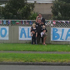 The Lowe family pose by their All Blacks sign on Great South Road in Papakura as they show support for the boys. Photo / Nigel Lowe