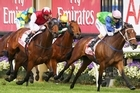 Hugh Bowman gets Sangster home in front of Godolphin's Induna in yesterday's VRC Derby. Photo / Getty Images