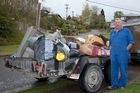 Larry Palmer with the rubbish left behind by his evicted tenant. Photo / Jessica Kate Williamson