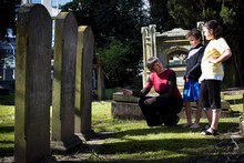 Diana Clement with her children Milo and Maia in Grafton St cemetery. Photo / Natalie Slade