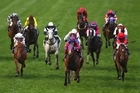 Pinker Pinker (centre) finishes clear of Jimmy Choux (right) in the Cox Plate at Moonee Valley on Saturday. Photo / Getty Images