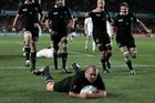 Prop Tony Woodcock scores the only All Black try on Sunday night.Pictures / Brett Phibbs