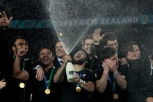 The All Blacks celebrate their close win. Photo / Brett Phibbs