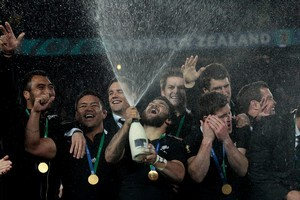 The All Blacks celebrate their close win. Photo / Brett Phibbs