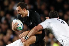 Full speed ahead for fullback Israel Dagg as he takes on two French tacklers during the All Blacks' skin-of-the-teeth win last night. Photo / Dean Purcell 