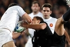 All Black fullback Israel Dagg loses a high ball to Damien Traille and injured himself when he landed awkwardly. Photo / Dean Purcell