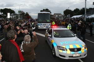 Rugby World Cup fans greet the All Blacks. Photo / Greg Bowker