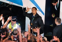 Jerome Kaino waves to fans as the All Blacks arrive back at the Heritage Hotel for an after-party following their win. Photo / Jason Dorday