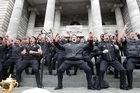 Skipper Richie McCaw leads the All Blacks in a rousing haka on the steps of Parliament. Photo / Mark Mitchell