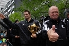 All Black captain Richie McCaw (L) with the Webb Ellis Cup and coach Graham Henry (R) during the All Blacks parade in Wellington. Photo / Sarah Ivey