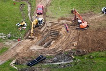 Erosion of the earth under the pipeline is thought to have caused a 13cm rupture and the best case scenario is for repairs to be complete within three days. Photo / SNPA