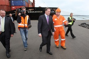 Prime minister John Key speaks to Drew Shannon, salvage co-ordinator of the Rena clean-up at the Port of Tauranga. Photo / Joel Ford