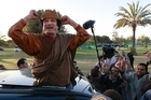 Former Libyan leader Moammar Gadhafi's final resting place will be at an unknown location in the open desert. Photo / AP