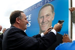 Prime Minister John Key appears on National Party billboards and alongside individual candidates. Photo / Christine Cornege