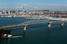 The harbour bridge is emblematic of Auckland's spread along its harbour and sea coasts. Photo / Brett Phibbs