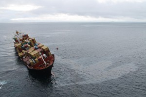 A sheen of oil can be seen having leaked from the Rena overnight Saturday/Sunday. Photo / Maritime New Zealand