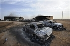 Burnt cars sit at the site of a blast in the Libyan town of Sirte on October 25, 2011 after a fuel tank exploded killing more than 100 people. Photo / AFP