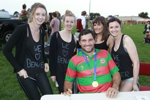 Stephen Donald and his World Cup winner's medal with Beaver fans (from left) Emma Bennett, Clare Garvey, Sam Campbell and Hannah Bennett at the Waiuku Rugby Club yesterday. Photo / Steven McNicoll