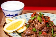 Chilli beef with rice, yoghurt, coriander and lemon. Photo / Babiche Martens