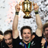 Richie McCaw holds up the cup following the All Blacks' win over France. Photo / Paul Estcourt