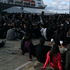 Rugby fans find a spot on Captain Cook Wharf and wait for the game to start. Photo / Herald online