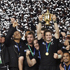 The All Blacks celebrate winning the Rugby World Cup tournament. Photo / Dean Purcell