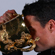 Injured All Black Dan Carter drinks from the Webb Ellis Cup. Photo / Getty Images