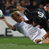 Aurelien Rougerie of France is tackled by All Black Jerome Kaino. Photo / Getty Images