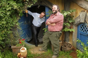Prime Minister John Key gets an inside look at a hobbit house with director Sir Peter Jackson. Photo / Alan Gibson