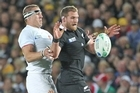 All Black Kieran Read wins lineout ball ahead of France's Imanol Harinordoquy. Photo / Paul Estcourt
