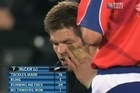 In this screenshot from the World Cup final broadcast, All Black captain Richie McCaw can be seen reacting to a possible eye gouge during the game.