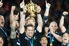 Richie McCaw lifts the Rugby World Cup. Photo / Ron Burgin