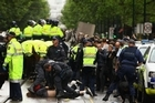 Police clashed with protesters in Melbourne yesterday, arresting 100 people. Photo / Getty Images