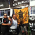 All Blacks fans parade with homemade signs at Britomart before the final. Photo / Herald online