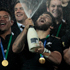All Blacks celebrate the winning of the Webb Ellis Trophy. Photo / Brett Phibbs