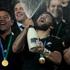 All Blacks celebrate the winning of the Webb Ellis Trophy. Photo / Brett Phibbs