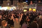 Fans celebrate the All Blacks' victory against the French in Auckland City fanzones.