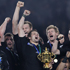 The All Blacks throw their fists up in joy. Photo / AP