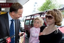 John Key startles Isabelle Mein, 2, as she clings to mother Cathy during a walkabout in Ponsonby. Photo / Dean Purcell